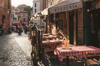 A restaurant on a cobbled street of Rome in the neighborhood of Trastevere