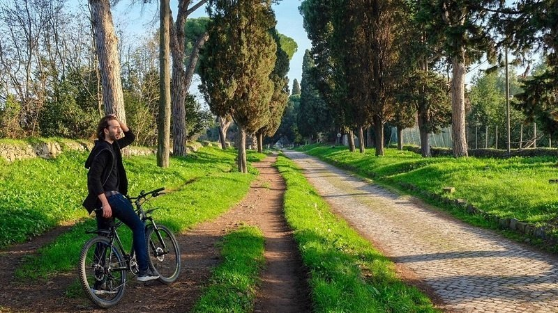Alexander on his bike on the Old Appian Way
